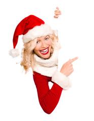 Blonde Weihnachtsfrau präsentiert Textfreiraum
