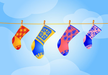 four Christmas socks hanging on the rope