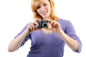 young beautiful woman with a camera (white background)