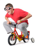 The curious man in goggles on a children's bicycle
