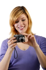young woman with a camera (white background - focus on camera)