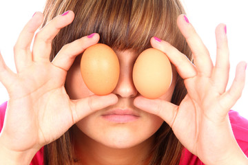 Teenage Girl Playing with Eggs. Model Released