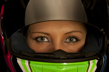 Female motorcycle driver with helmet on