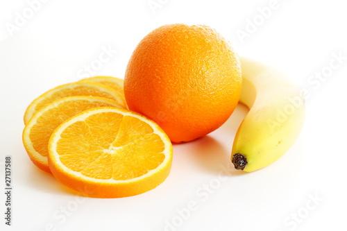 Fotobehang Plakjes fruit Orange mit Orangenscheiben und Banane