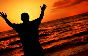 Silhouette Of Worshipping Man