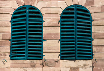Old windows with green shutters