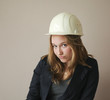 Pretty girl with construction helmet
