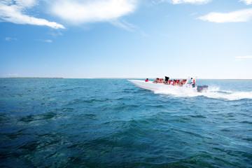 people on speedboat, Dominican republic