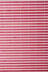 Textura de una estera de bambú roja.