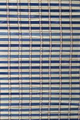 Textura de una estera de bambú azul.
