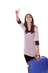 young woman with suitcase calling for a taxi