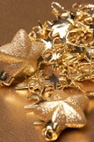 Christmas gold stars on the gold background
