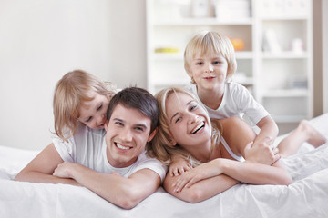 Smiling parents with children at home