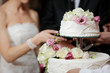 Bride And Groom Cutting Cake - 27155194