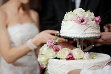 """Постер, картина, фотообои """"Bride And Groom Cutting Cake"""""""