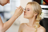 Fototapety Young beautiful bride applying wedding make-up