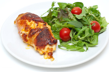 chicken wrapped in bacon served with salad