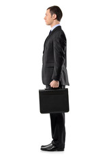 Full length portrait of a businessman holding a leather briefcas