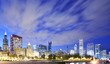 Chicago skyline at night with dramatic clouds