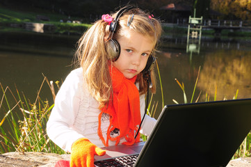 Lakeside girl with laptop