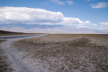 Dirt road across Badwater Basin salt flats, Death Valley NP