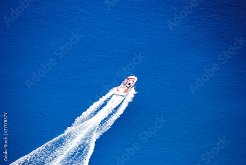 Blue sea, powerboat, white wave