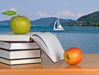 books and apples on desk