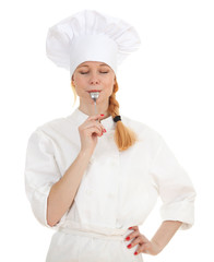 keeping spoon female cook in white uniform and hat