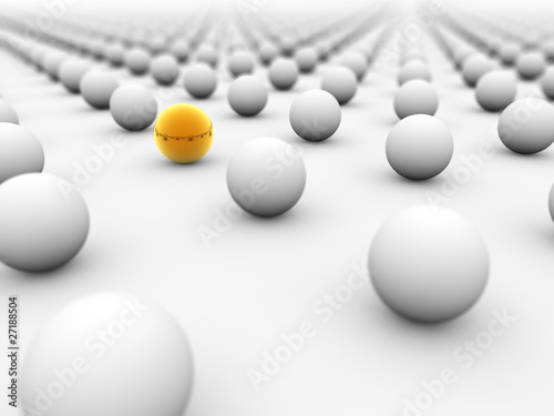 Golden ball surrounded by white ones with the focus on it.