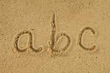 alphabet letters a b c handwritten in sand on beach poster