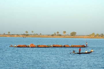 Boats carrying goods across river in Africa