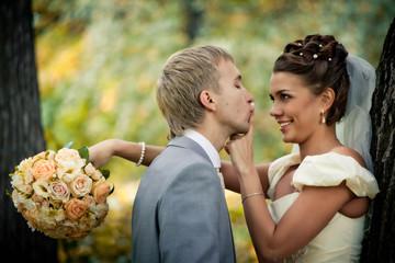 Portrait of newlyweds in autumn park