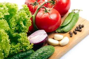 Fresh vegetables on wooden hardboard
