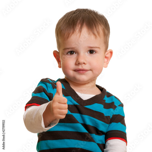 Portrait of a handsome smiling toddler in casual isolated on whi