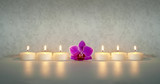 Kerzen mit Orchidee