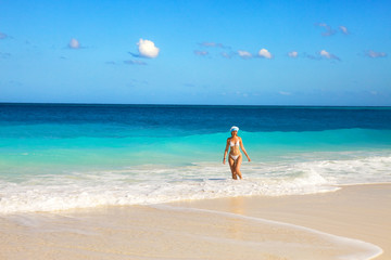 The girl on an ocean coast in the New Year's cap,