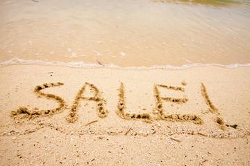"Inscription ""SALE"" on sand"
