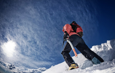 Climber on a snowy ridge