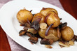 Roasted potatoes with red onion, garlic and mushrooms