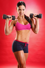 Fitness model and dumbbell routine