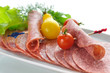 Sliced Salami with tomatoes and salad leaves