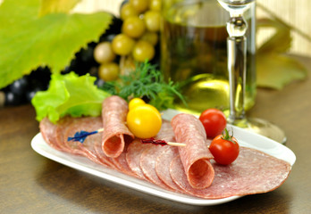 white wine with salami and grape