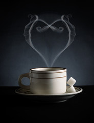 Fresh coffee with steam shaped as heart
