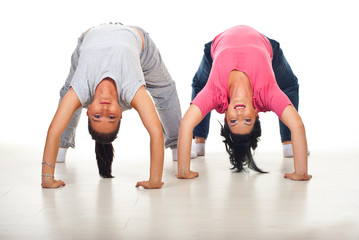 Two flexible women doing back-bend