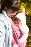 Walk with the child in a baby sling. Breastfeeding poster
