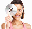 Beautiful woman on white background holding CD against white