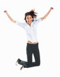 Casual woman jumping in joy isolated over white