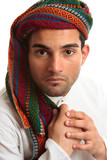 Mixed race middle eastern man wearing turban robe poster