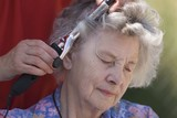 Elderly Woman Having Hair Curled