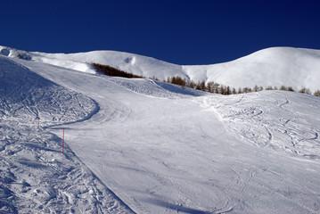 Ski slope to ski resort in the Italian Alps